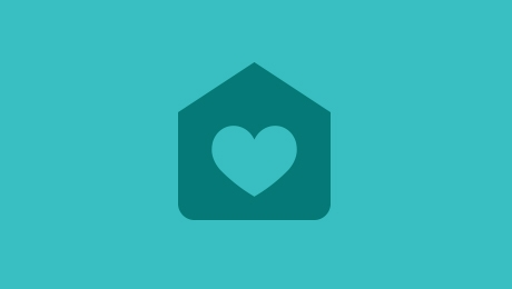 Green home and heart icon